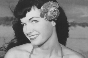 BETTIE, mid 20s. Don't let her all-American looks fool you. Trouble goes out of its way to avoid HER.
